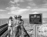 [Men Standing by Historical Marker, Pecos River High Bridge, Southern Pacific Railroad]