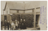 [Family standing for portrait before building, possibly Bonita Hotel, Bonita, Texas]