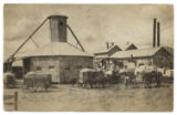 [Wagons loaded with cotton at cotton gin]
