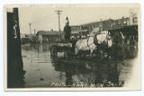 [Man driving wagon through flooded streets, Burkburnett, Texas]