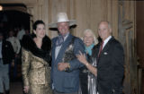 [Nancy Brinker (left), Larry Hagman, and Norman Brinker (far right) at the Rosewood Crescent Club]
