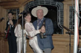 [Larry Hagman and performers at the Rosewood Crescent Club]