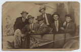 [Men in a touring car with 1915 State Fair of Texas in Dallas banner]