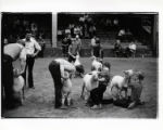 [Exhibitors with their sheep at livestock show, State Fair of Texas]