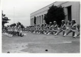 [Drill team in rows performing at the State Fair of Texas]