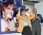 [Elizabeth Taylor with purple cowboy hat at Neiman Marcus store, Dallas]