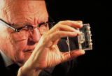 [Jack Kilby holding first integrated circuit in plastic case]
