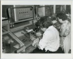 [TI Semiconductor Building, women on assembly line]