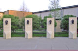 [Busts of TI founders outside TI South Campus main headquarters]