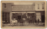 [Men and horse-drawn wagon in front of liquor store, Aspen, Colorado]